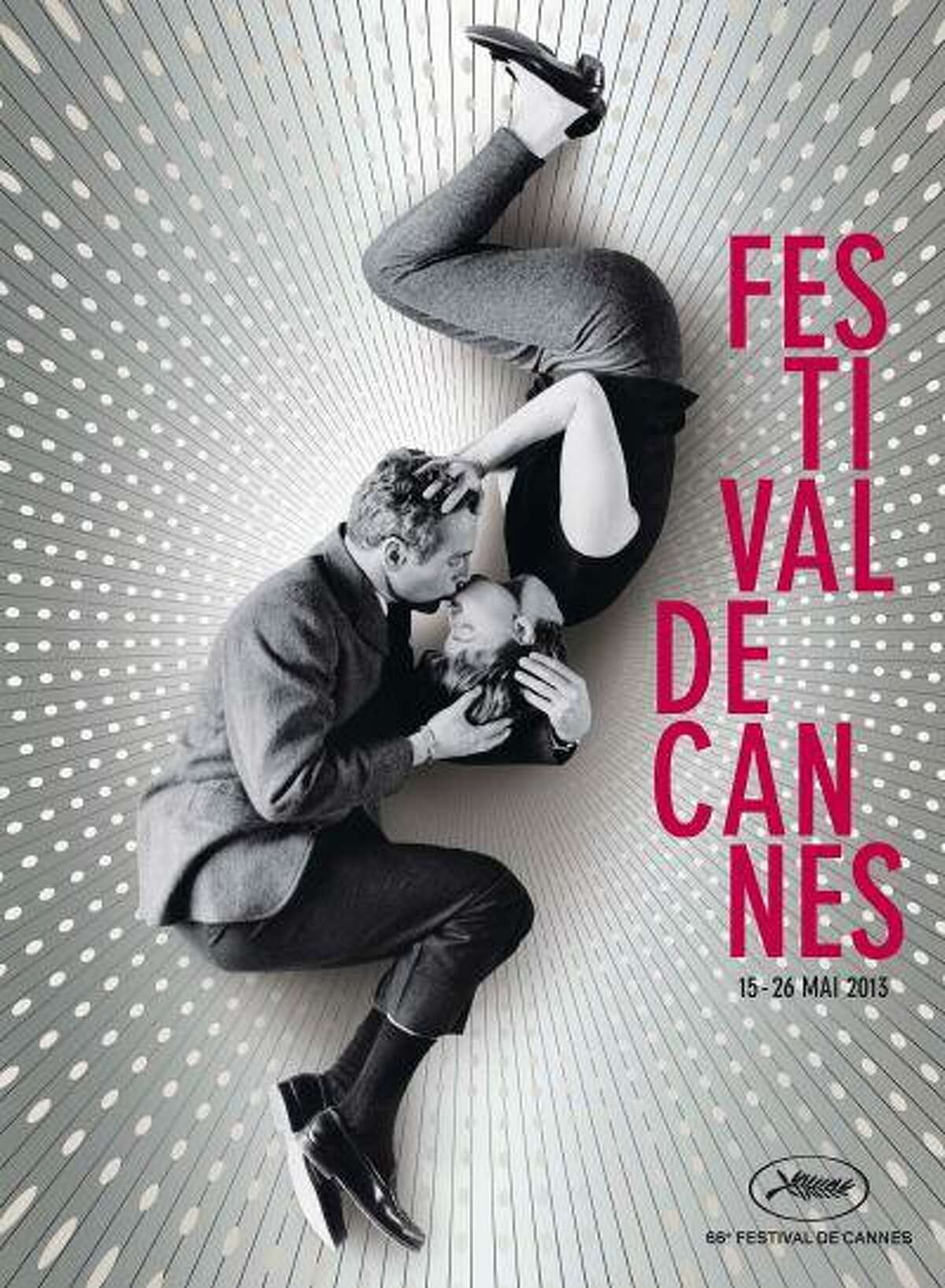 """The official poster of the 66th Cannes Film Festival, taken from a picture of Joanne Woodward and Paul Newman during the shooting of """"A New Kind of Love"""", by director Melville Shavelson in 1963, is seen in this handout image released to Reuters on April 18, 2013. Organizers announced the competing films at a news conference in Paris April 18, 2013. Hollywood stars will mingle with filmmakers from all over the world at next month's Cannes Film Festival after organisers on Thursday unveiled a line-up heavy with international films. The films to be shown at the world's most important cinema showcase were announced in a cinema on the Champs-Elysees underneath a huge video screen of this year's Cannes poster - Paul Newman and Joanne Woodward curled up kissing. REUTERS/Festival de Cannes/l'Agence Bronx/Handout (FRANCE - Tags: SOCIETY ENTERTAINMENT) ATTENTION EDITORS - THIS IMAGE WAS PROVIDED BY A THIRD PARTY. THIS PICTURE IS DISTRIBUTED EXACTLY AS RECEIVED BY REUTERS, AS A SERVICE TO CLIENTS. NO COMMERCIAL OR BOOK SALES. FOR EDITORIAL USE ONLY. NOT FOR SALE FOR MARKETING OR ADVERTISING CAMPAIGNS"""