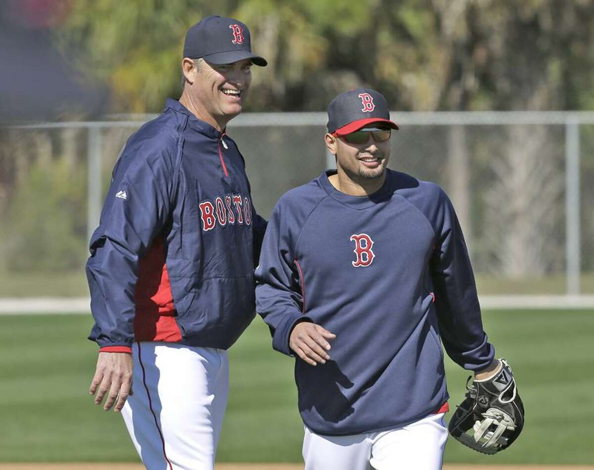 Boston Red Sox outfielder Shane Victorino, right, and manager John Farrell share a light moment during a spring training workout Sunday, Feb. 17, 2013, in Fort Myers, Fla. (AP Photo/Chris O'Meara)
