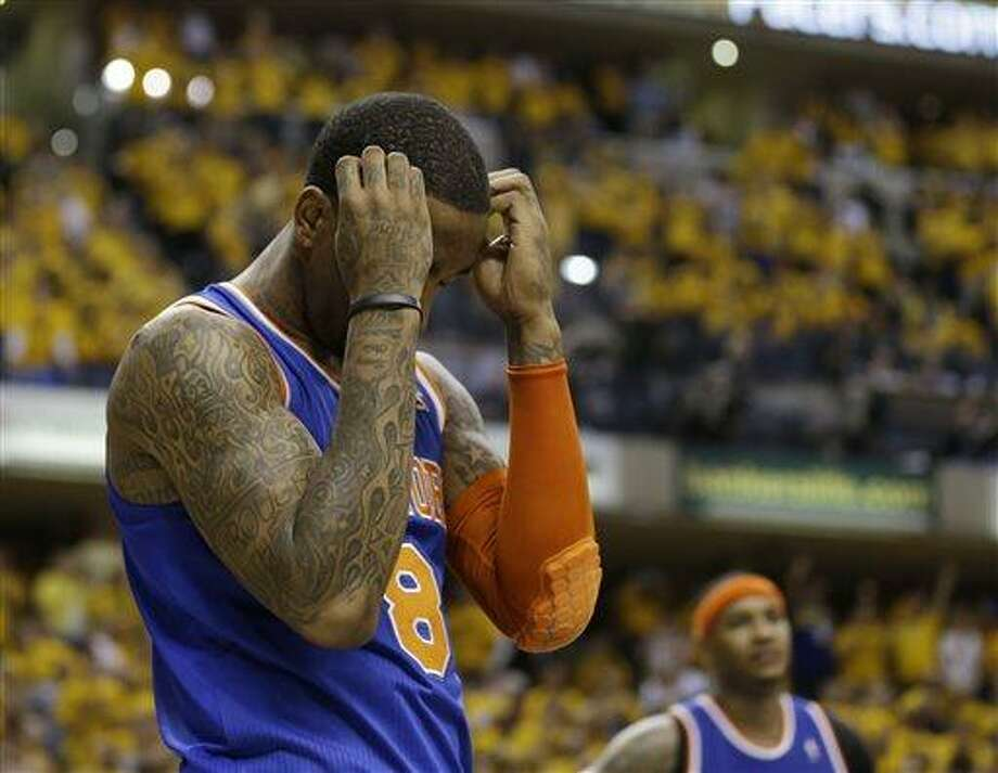 New York Knicks' J.R. Smith reacts late during the second half of Game 6 of an Eastern Conference semifinal NBA basketball playoff series against the Indiana Pacers, Saturday, May 18, 2013, in Indianapolis. Indiana defeated New York 106-99 to win the series 4-2. (AP Photo/Darron Cummings) Photo: AP / AP
