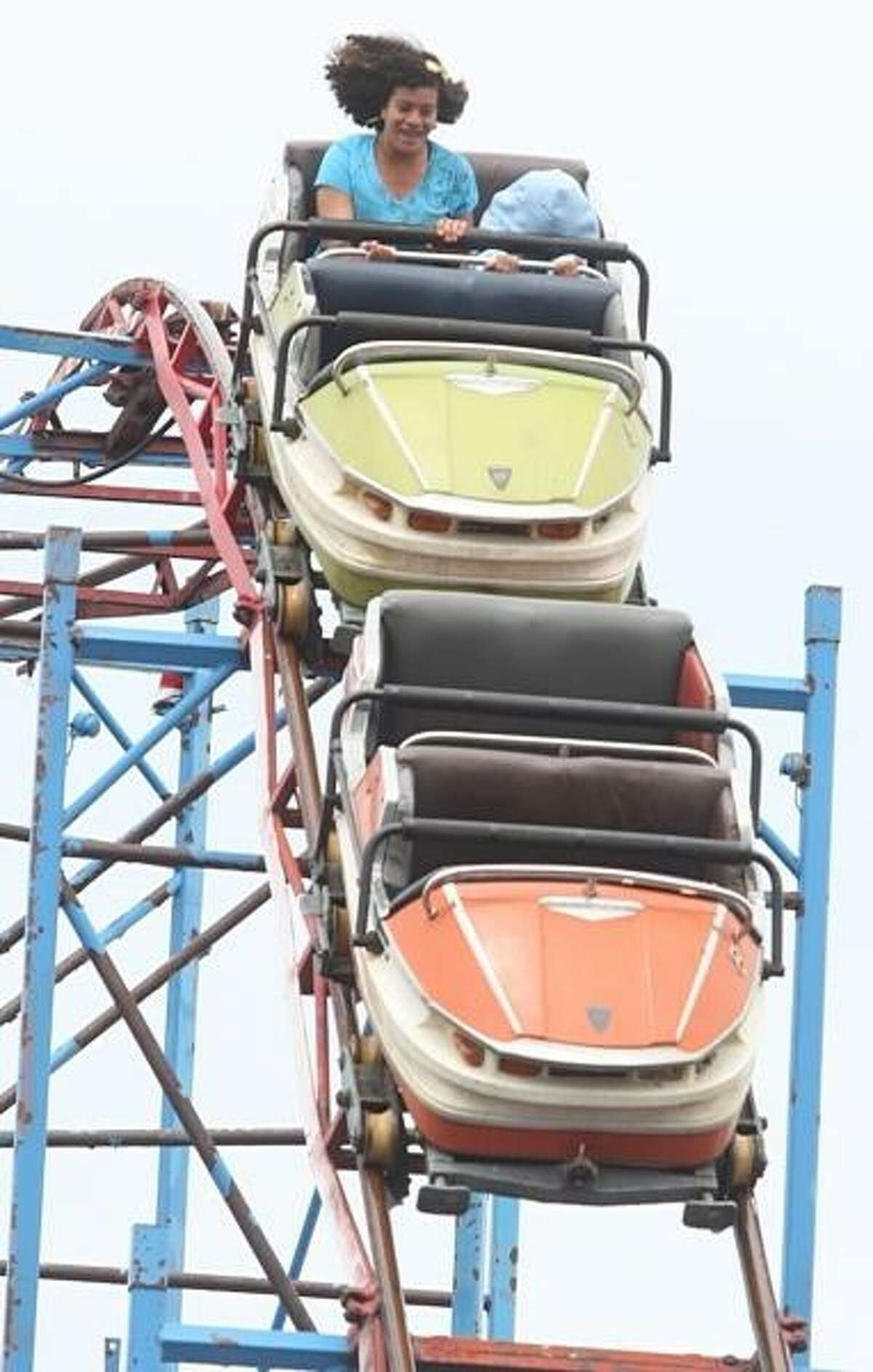 PHOTO BY JOHN HAEGER @ ONEIDAPHOTO ON TWITTER/ONEIDA DAILY DISPATCH Riders hang on as they ride the roller coster at Sylvan Beach Amusement Park on Saturday, May 18, 2013.