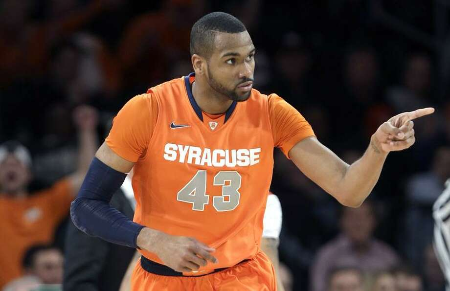 Syracuse's James Southerland (43) reacts after scoring during the first half of an NCAA college basketball championship game against Louisville at the Big East Conference tournament Saturday, March 16, 2013, in New York. (AP Photo/Frank Franklin II) Photo: AP / AP