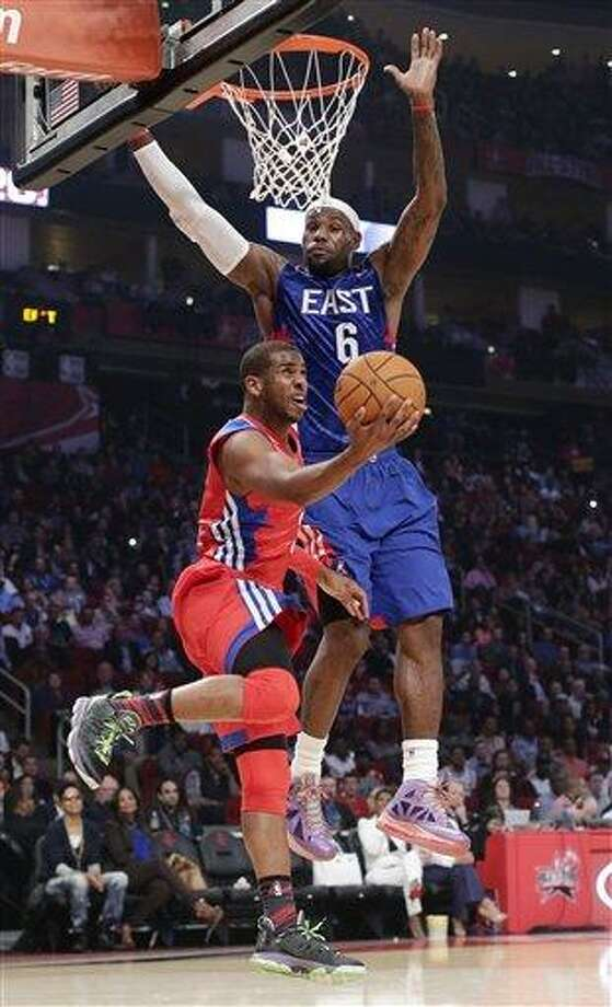 West Team's Chris Paul of the Los Angeles Clippers shoots against East Team's LeBron James of the Miamia Heat during the first half of the NBA All-Star basketball game Sunday, Feb. 17, 2013, in Houston. (AP Photo/Eric Gay) Photo: AP / AP