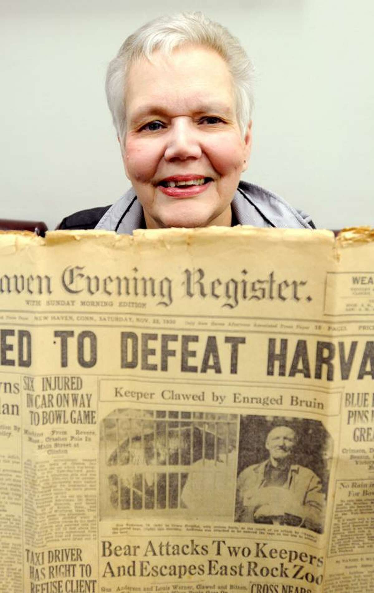 Donna Maturo, at the New Haven Register Wednesday, May, 15, 2013. Maturo is the great-granddaughter of Gustave Anderson, the caretaker who was killed by the a bear attack at East Rock Zoo in1930. Maturo holds the New Haven Evening Register newspaper that had the story on the front page on November 22, 1930. Photo by Peter Hvizdak / New Haven Register