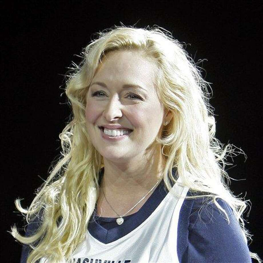 FILE - In this Nov. 14, 2008 file photo, Country singer Mindy McCready performs, in Nashville, Tenn. McCready, who hit the top of the country charts before personal problems sidetracked her career, died Sunday, Feb. 17, 2013. She was 37. (AP Photo/Mark Humphrey, File) Photo: ASSOCIATED PRESS / A2008