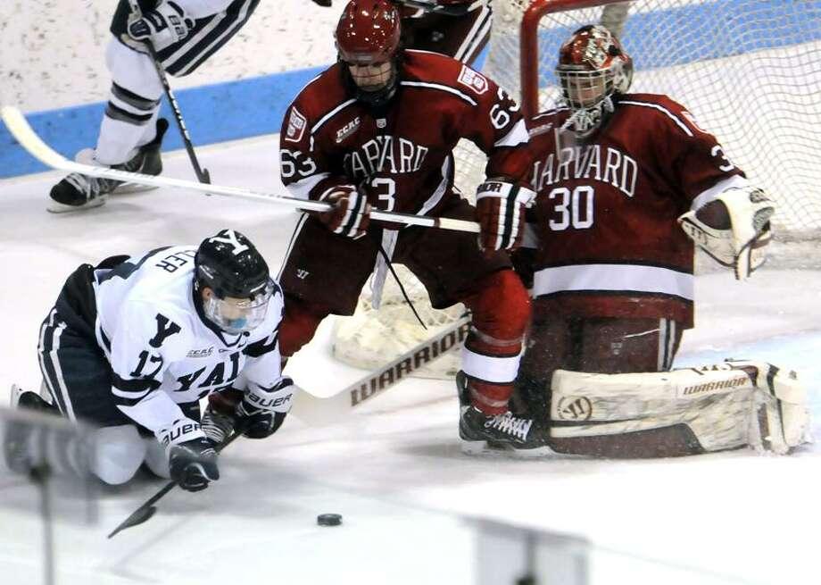 Harvard at Yale, men's hockey, Ingalls Rink. Yale's Andrew Miller, Harvard's Colin Blackwell, goalie Raphael Girard.  Mara Lavitt/New Haven Register1/18/13
