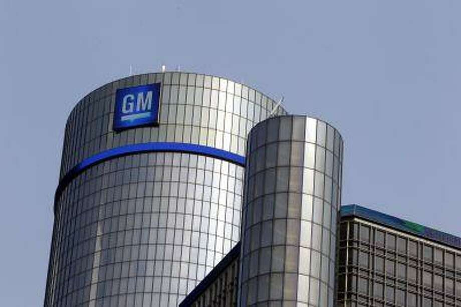 The General Motors logo and a blue light band are displayed atop the Renaissance Center in Detroit June 8, 2011. Photo: ASSOCIATED PRESS / AP2011