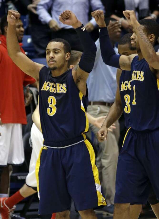 North Carolina A&T guard Jeremy Underwood (3) celebrates after they defeated Liberty 73-72 in a first round NCAA college basketball tournament game, Tuesday, March 19, 2013, in Dayton, Ohio. Underwood led North Carolina A&T with 19 points. (AP Photo/Al Behrman) Photo: AP / AP2013