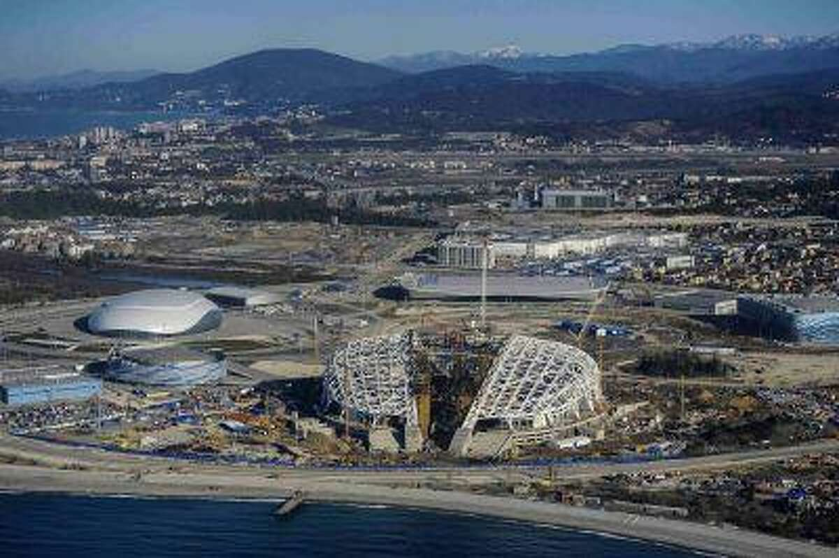A view from a helicopter shows the Fisht Olympic Stadium (C) and other Olympic venues under construction for the 2014 Winter Olympic games in Sochi March 7, 2013. While Moscow digs itself out of a huge snow storm that hit the Russian capital in the last few days, organisers of the Winter Olympics are worried a lack of white powder could become a problem next February. Picture taken March 7, 2013. REUTERS/Nina Zotina/Files (RUSSIA - Tags: SPORT OLYMPICS CITYSCAPE ENVIRONMENT)