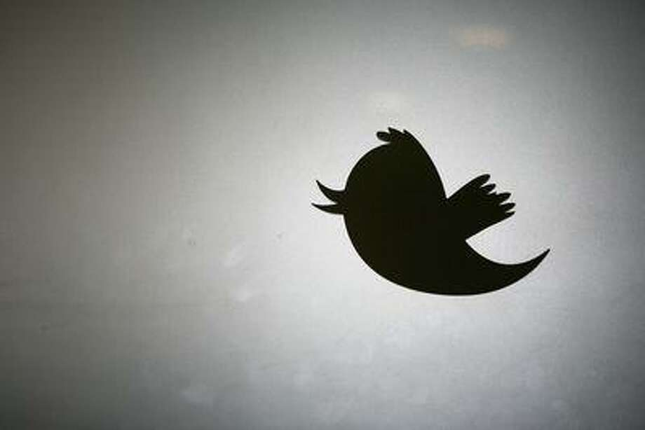 The Twitter logo is displayed at the entrance of Twitter headquarters in San Francisco in this March 11, 2011 file photo. Photo: AFP/Getty Images / AFP ImageForum