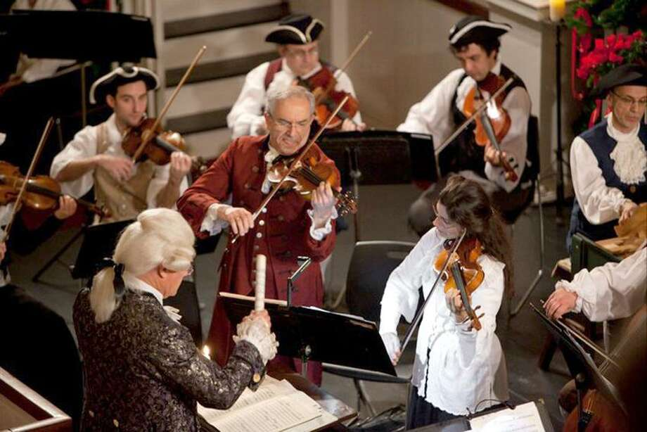 Harold Shapiro photo: Violinist Raphael Ryger, center, here at ONE's annual Colonial Concert.