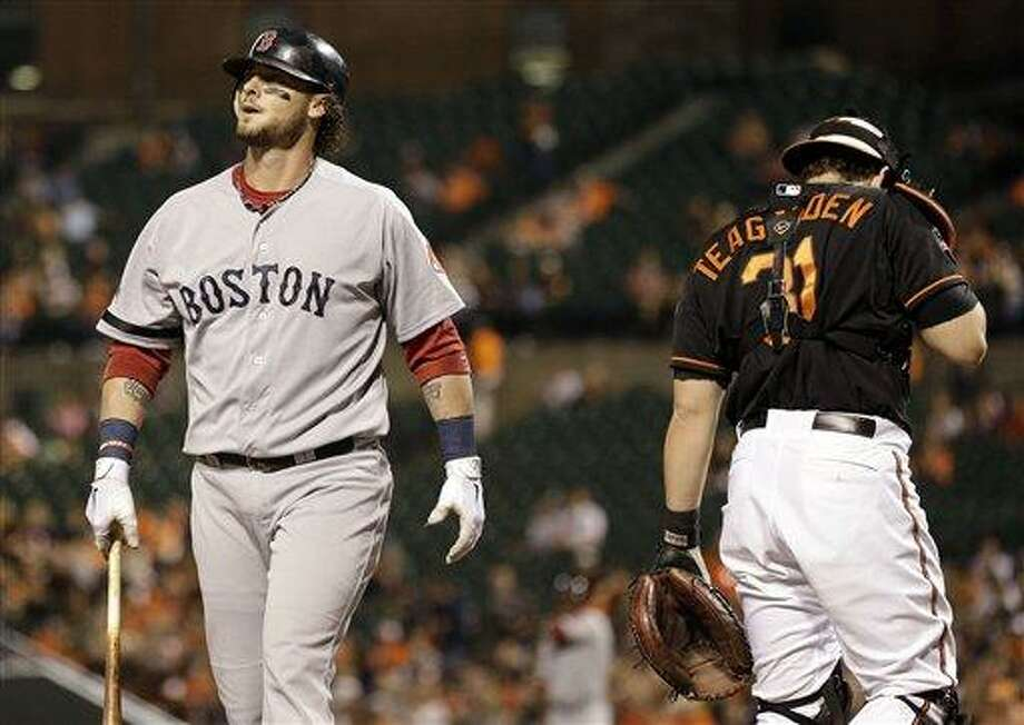 Boston Red Sox' Jarrod Saltalamacchia, left, walks off the field past Baltimore Orioles catcher Taylor Teagarden after striking out in the second inning of a baseball game in Baltimore, Friday, Sept. 28, 2012. (AP Photo/Patrick Semansky) Photo: ASSOCIATED PRESS / AP2012