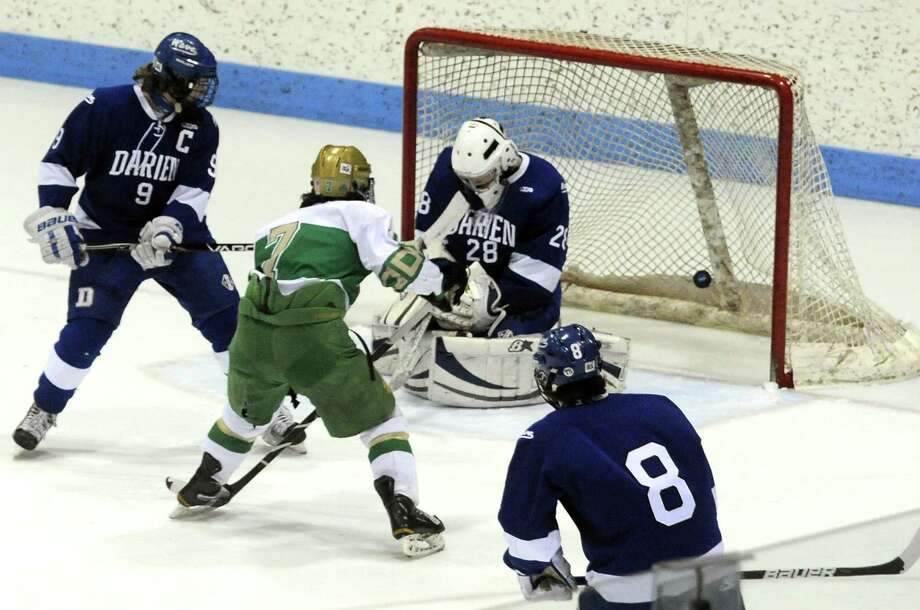 Notre Dame-West Haven's Kevin Coyle scores his team's second goal of the game against Darien in the Division 1 hockey semifinals at Ingalls Rink in New Haven. Notre Dame faces Fairfield Prep in the final on Tuesday, weather permitting. vmWilliams/Register
