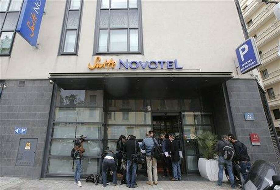 Reporters gather outside the Novotel hotel during the 66th international film festival, in Cannes, southern France, Friday, May 17, 2013. A French police official says a thief or thieves stole about $1 million worth in jewelry inside a safe in a Novotel hotel room, against the backdrop of the Riviera resort town's film festival. (AP Photo/Lionel Cironneau) Photo: AP / AP