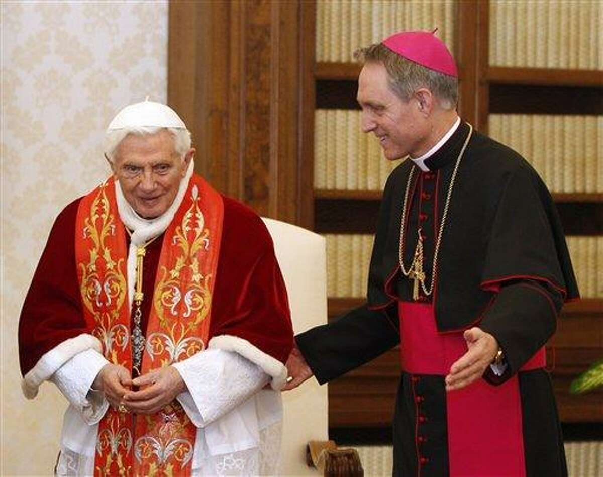 Pope Benedict XVI and his personal secretary Georg Gaenswein leave after meeting Guatemala's President Otto Perez Molina, not seen, during a private audience at Vatican, Saturday, Feb. 16, 2013. (AP Photo/Alessandra Tarantino, pool)
