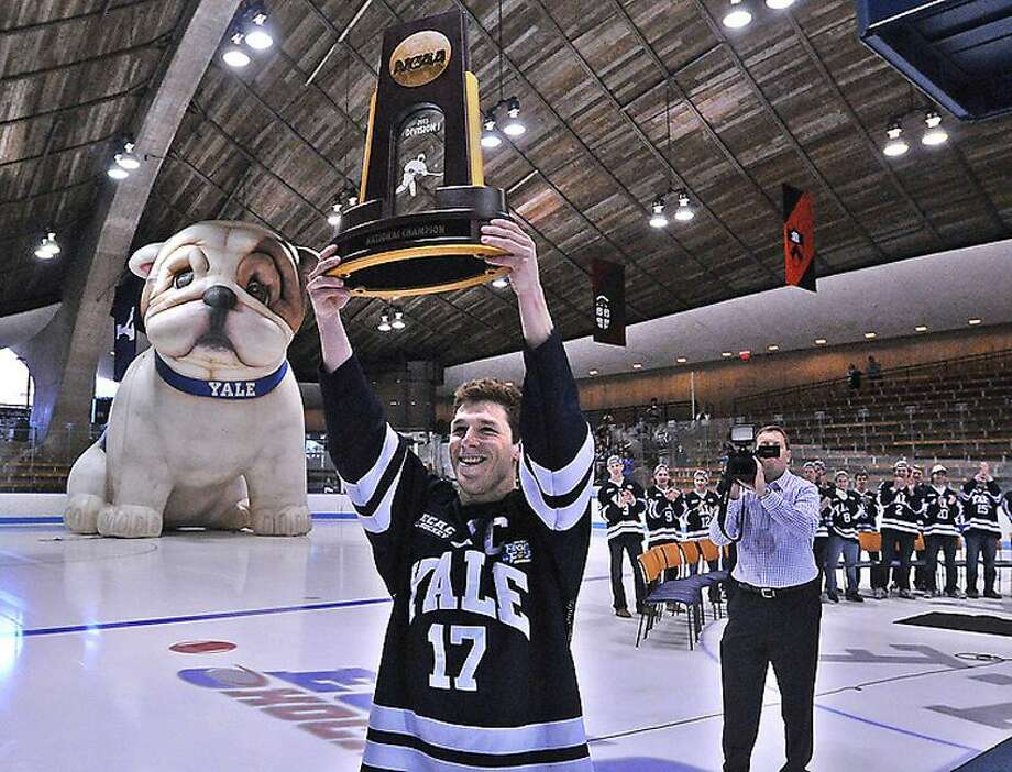 "Yale's Andrew Miller carries the NCAA Hockey National Championship trophy into Ingalls Rink as they held a ceremony for the returning champions on Monday. Miller signed an entry-level contract with the Edmonton Oilers on Wednesday.  Photo-Peter Casolino/Register  <a href=""mailto:pcasolino@newhavenregister.com"">pcasolino@newhavenregister.com</a>"