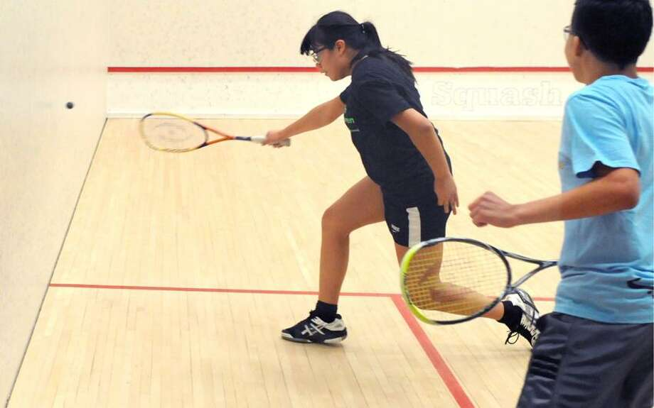 Alexandra Matamoros of New Haven, 15, left, returns a volley to opponent Laurent Briones of New Haven, 14, during a game at Squash Haven, a program at Yale University's Brady Squash Center,  that takes local children that promotes leadership through the sport of squash and classroom study. Wednesday, February 6,  2013. Photo by Peter Hvizdak / New Haven Register Photo: New Haven Register / ©Peter Hvizdak /  New Haven Register