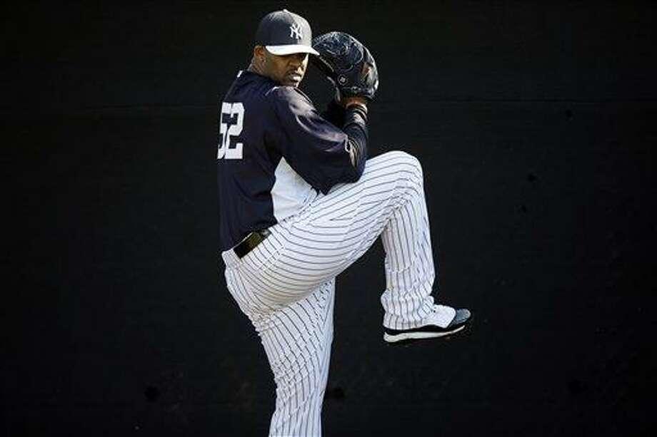 New York Yankees' CC Sabathia pitches during a workout at baseball spring training, Saturday, Feb. 16, 2013, in Tampa, Fla. (AP Photo/Matt Slocum) Photo: AP / AP
