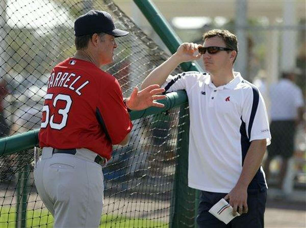 Boston Red Sox manager John Farrell, left, talks to general manager Ben Cherington after a team workout Wednesday, Feb. 13, 2013, in Fort Myers, Fla. (AP Photo/Chris O'Meara)