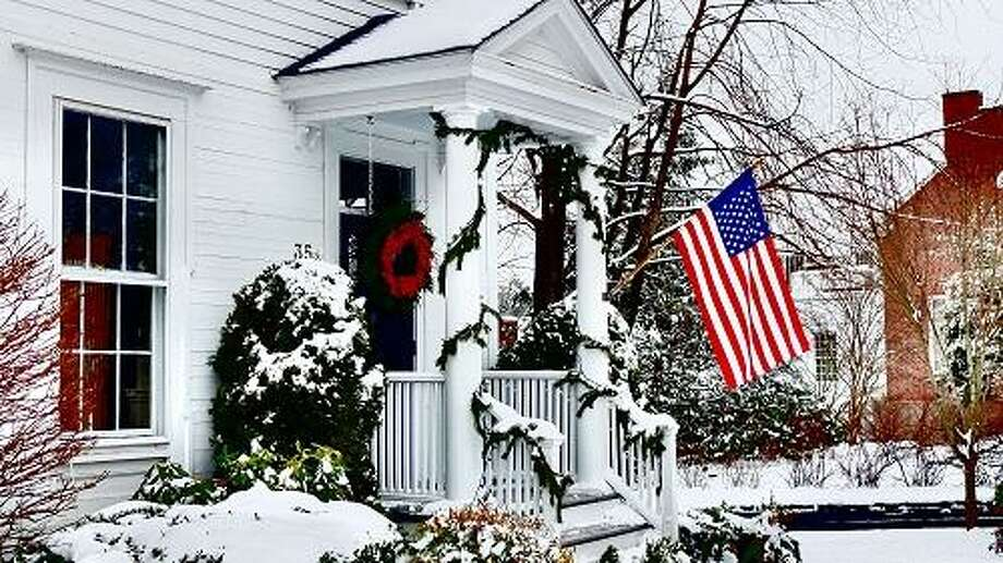 Newtown--Fresh snowfall covers one of the houses along Main Street in Newtown, which is regaining some sense of normalcy since the Sandy Hook shootings a month ago. Photo-Peter Casolino 1/16/13