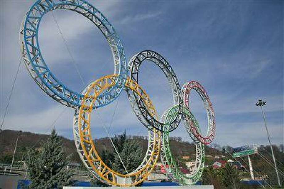 Olympic rings for the 2014 Winter Olympics are installed in the Black Sea resort of Sochi, southern Russia Sept. 25, 2012. Photo: AP / 2013 AP