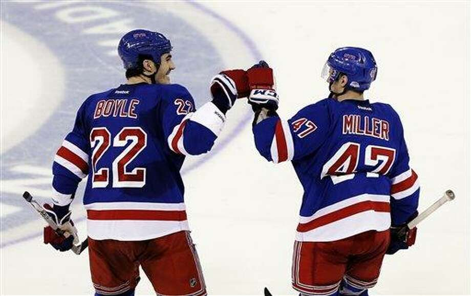New York Rangers' Brian Boyle (22) and J.T. Miller (47) celebrate after the shootout of an NHL hockey game against the Carolina Hurricanes, Monday, March 18, 2013, in New York. The Rangers won 2-1. (AP Photo/Frank Franklin II) Photo: AP / AP