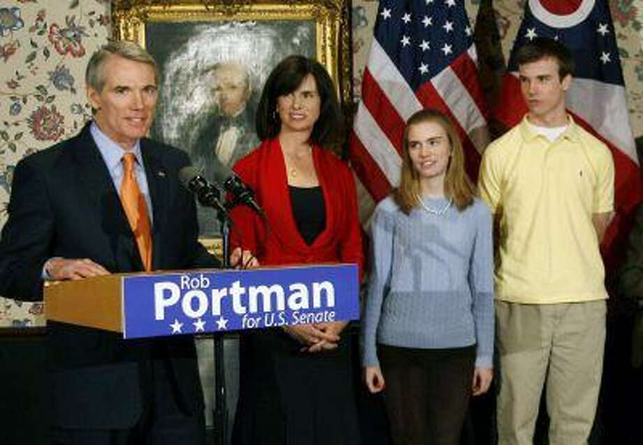In this Wednesday, Jan. 14, 2009 photo, U.S. Sen. Rob Portman, from left, with his wife, Jane, daughter Sally, and son Will, stands after announcing that he will run for the U.S. Senate, in Lebanon, Ohio. Portman is now supporting gay marriage and says his reversal on the issue began when he learned his son Will is gay. (AP Photo/David Kohl) Photo: AP / FR51830 AP