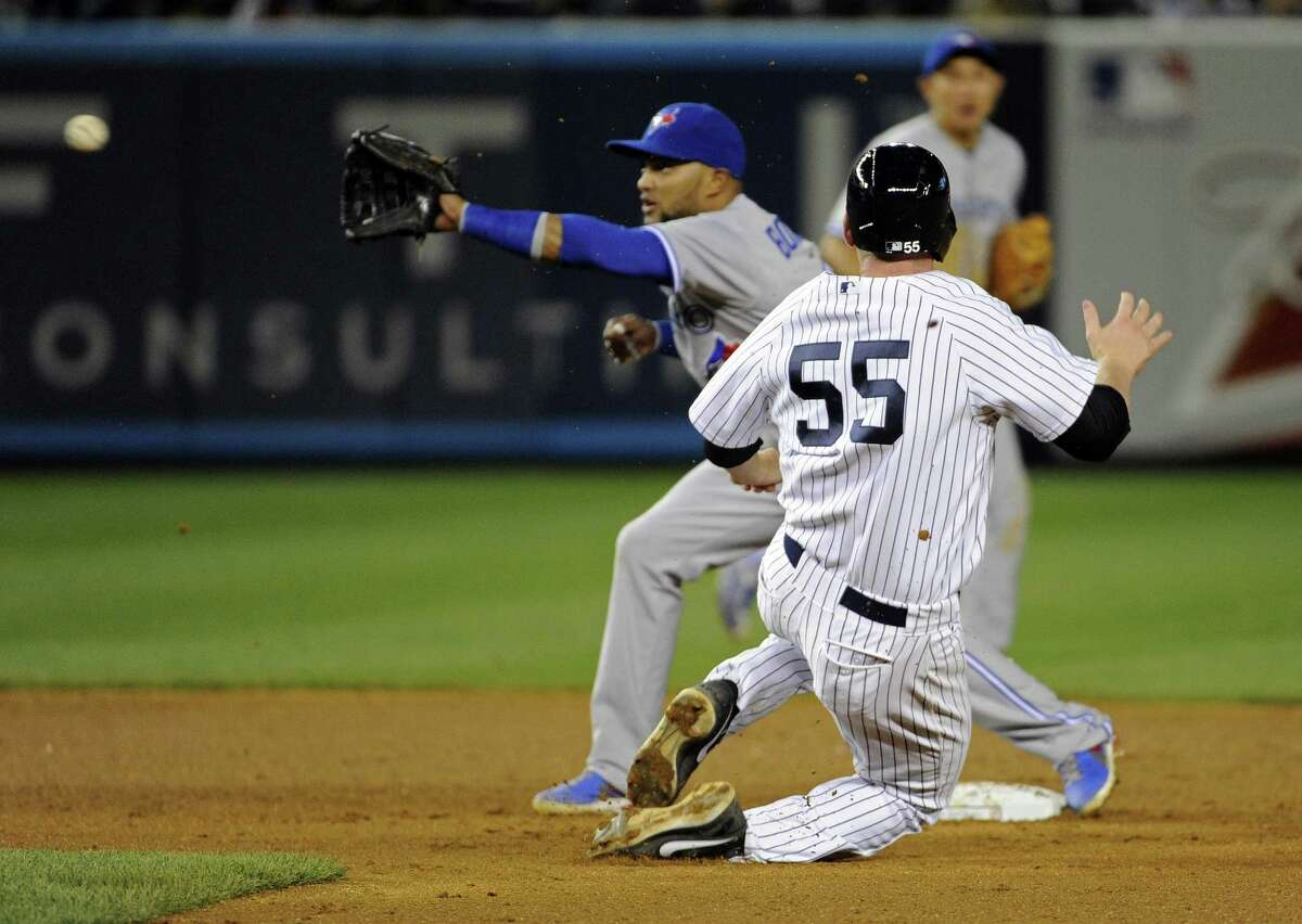 New York Yankees' Lyle Overbay (55) steals second base as Toronto Blue Jays second baseman Emilio Bonifacio waits for the ball during the eighth inning of a baseball game Friday, May 17, 2013, at Yankee Stadium in New York. (AP Photo/Bill Kostroun)