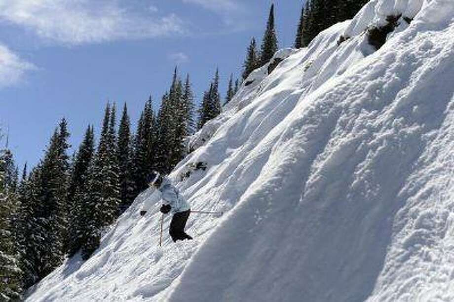 Kara Shay, above, of Kentucky heads down a steep face of the Prima Cornice run at Vail Mountain on Wednesday. (Andy Cross, The Denver Post) Photo: DP / Copyright - 2013 The Denver Post, MediaNews Group.