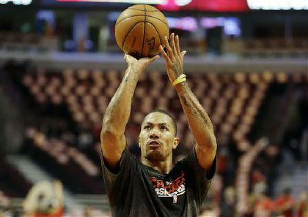 Chicago Bulls point guard Derrick Rose warms up before Game 4 against the Miami Heat, May 13, 2013, in Chicago.