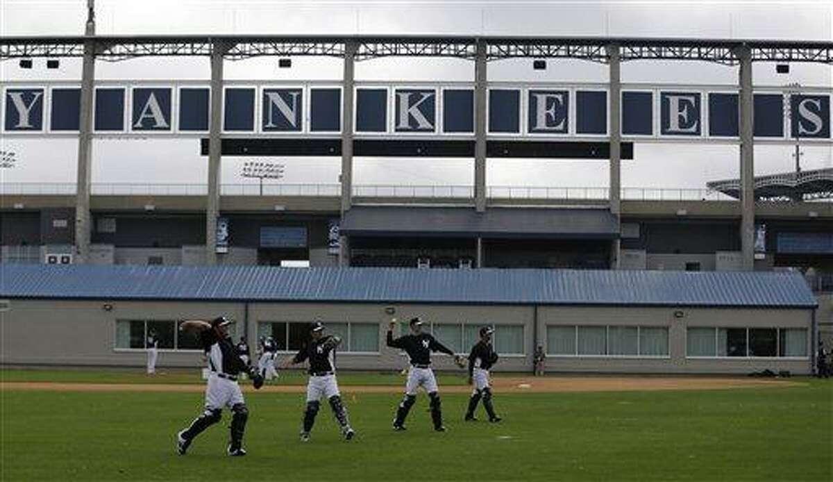 New York Yankees' players workout at baseball spring training, Wednesday, Feb. 13, 2013, in Tampa, Fla. (AP Photo/Matt Slocum)