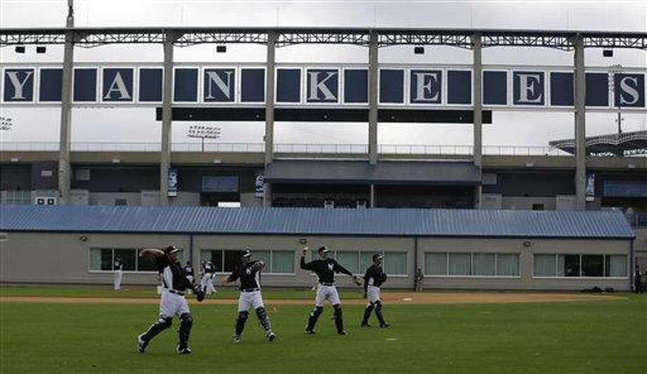 New York Yankees' players workout at baseball spring training, Wednesday, Feb. 13, 2013, in Tampa, Fla. (AP Photo/Matt Slocum) Photo: AP / AP