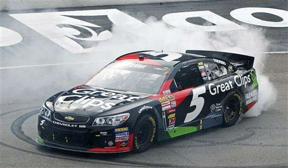 NASCAR Sprint Cup Series driver Kasey Kahne (5) does a burnout after winning the Food City 500 auto race, Sunday, March 17, 2013, in Bristol, Tenn. (AP Photo/Wade Payne) Photo: AP / FR23601 AP