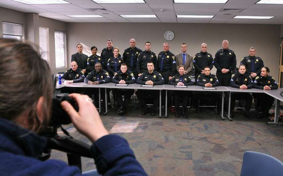 West Haven-- Recently promoted New Haven police sergeants get their photo taken by detective Matthew Prinz after they completed a 2-week leadership school program at UNH. 19 New sergeants competed the course.  Photo-Peter Casolino 2/15/13