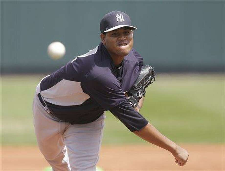 New York Yankees starting pitcher Ivan Nova throws during the first inning of an exhibition spring training baseball game against the Pittsburgh Pirates, Sunday, March 17, 2013 in Bradenton, Fla. (AP Photo/Carlos Osorio) Photo: AP / AP