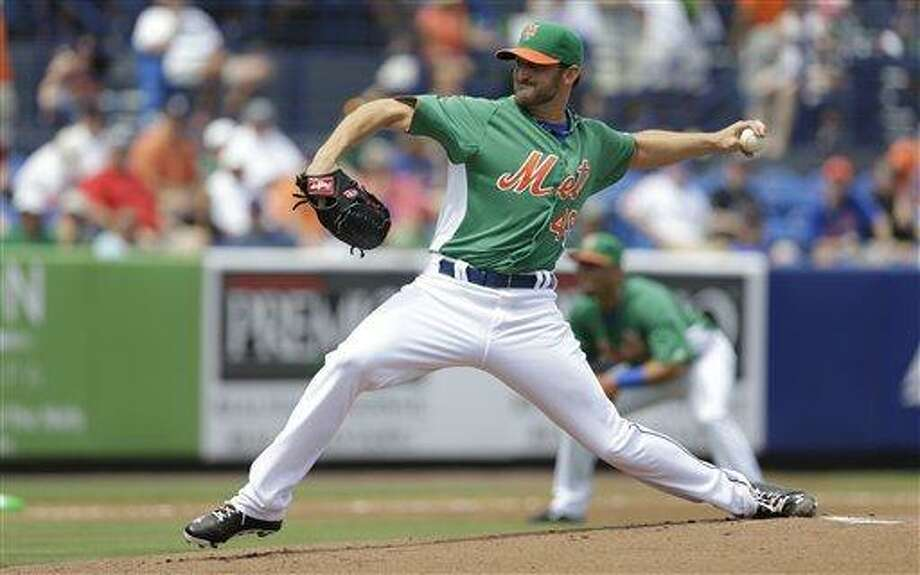 New York Mets starting pitcher Jonathon Niese throws during the first inning of an exhibition spring training baseball game against the Atlanta Braves, Sunday, March 17, 2013, in Port St. Lucie, Fla. (AP Photo/Jeff Roberson) Photo: AP / AP