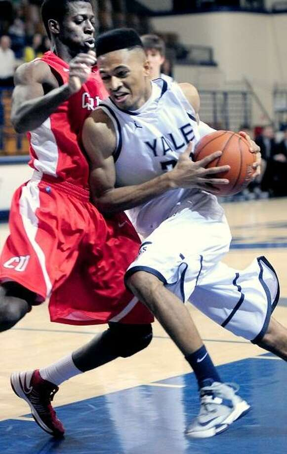 Miles Asafo-Adjei (left) of Cornell defends against Javier Duren (right) of Yale in the first half on 2/15/2013.Photo by Arnold Gold/New Haven Register