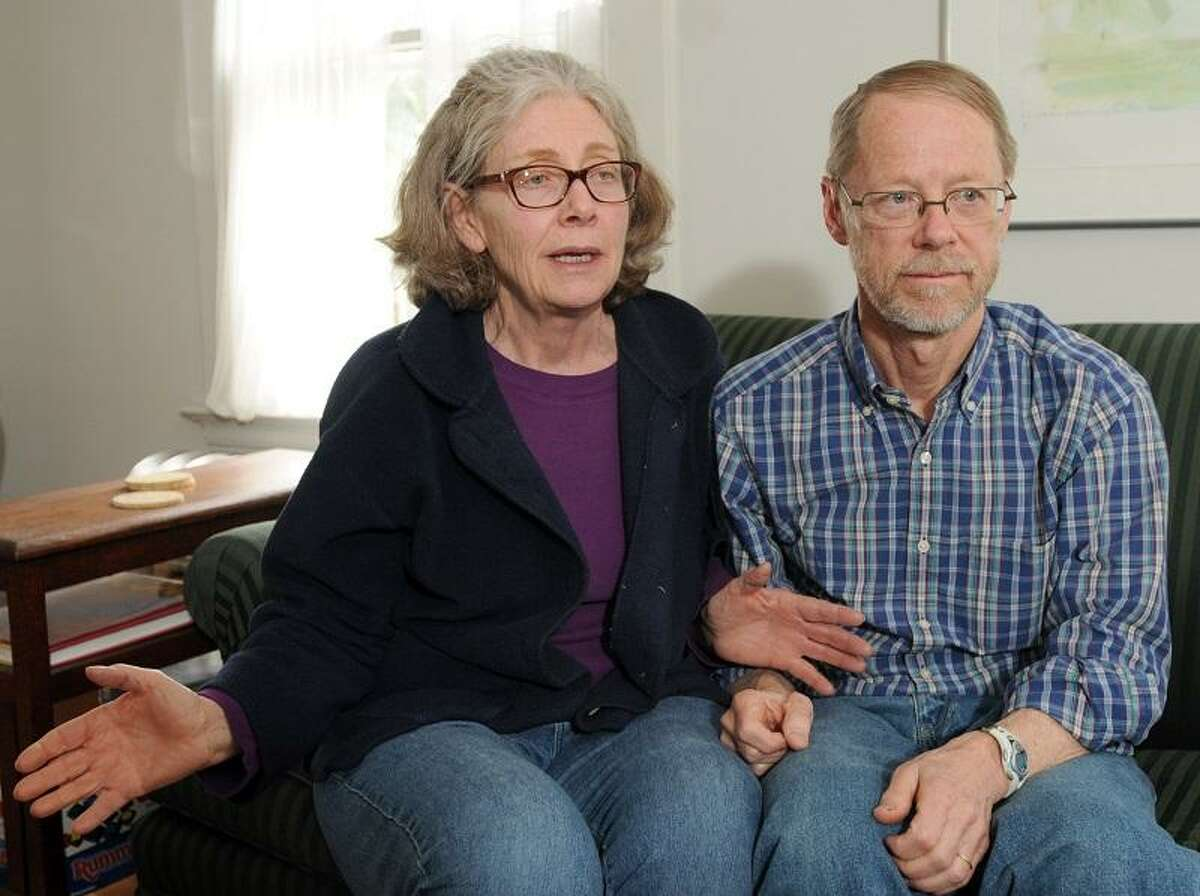 Alan Hagyard, who was a runner near the Boston Marathon finish line when a bomb exploded there yesterday, who with wife Christine Anderson, recount their experience Tuesday April 15, 2013 at their Hamden, Connecticut home. Photo by Peter Hvizdak / New Haven Register