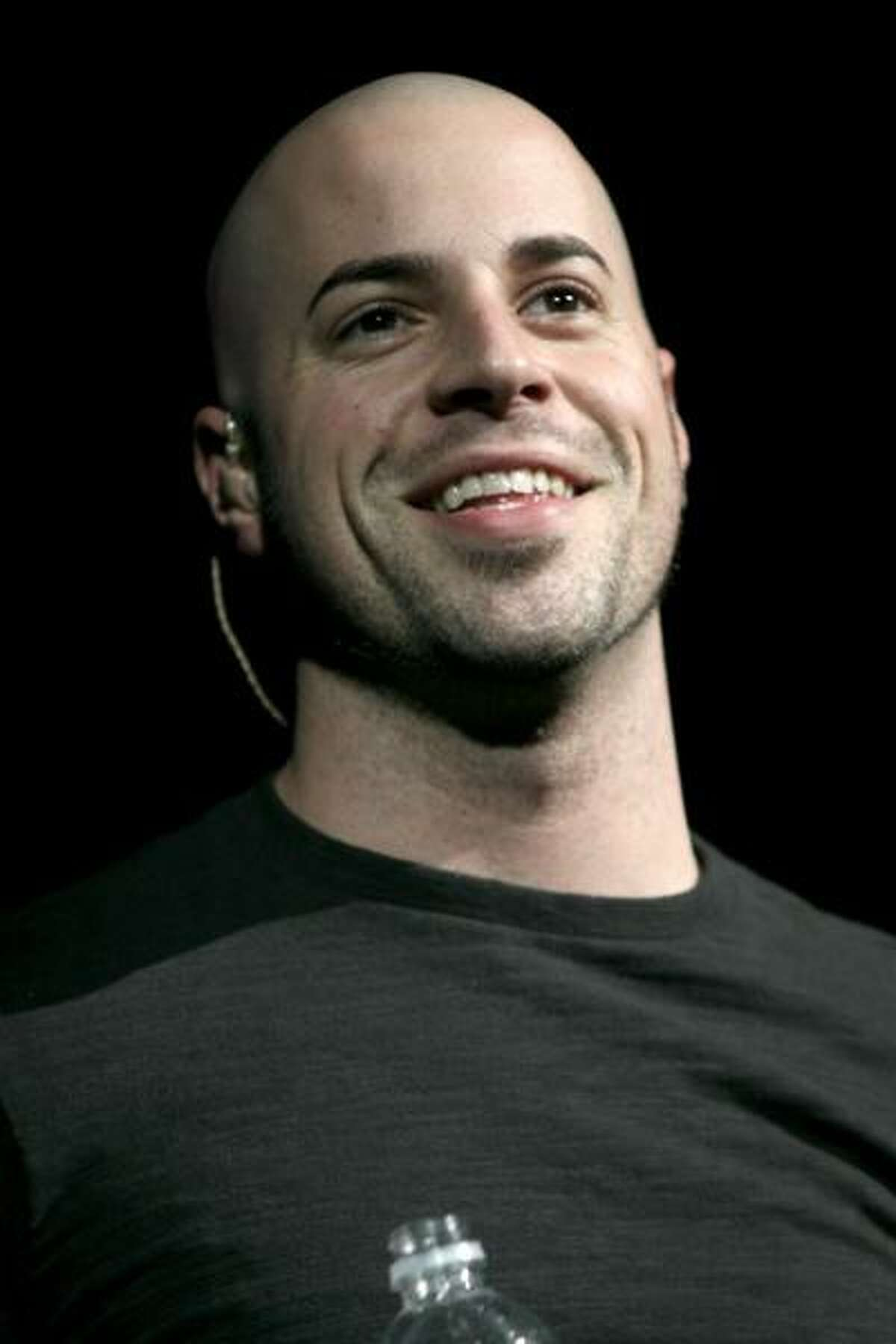 American Idol finalist Chris Daughtry is shown fronting his own band during a concert appearance.