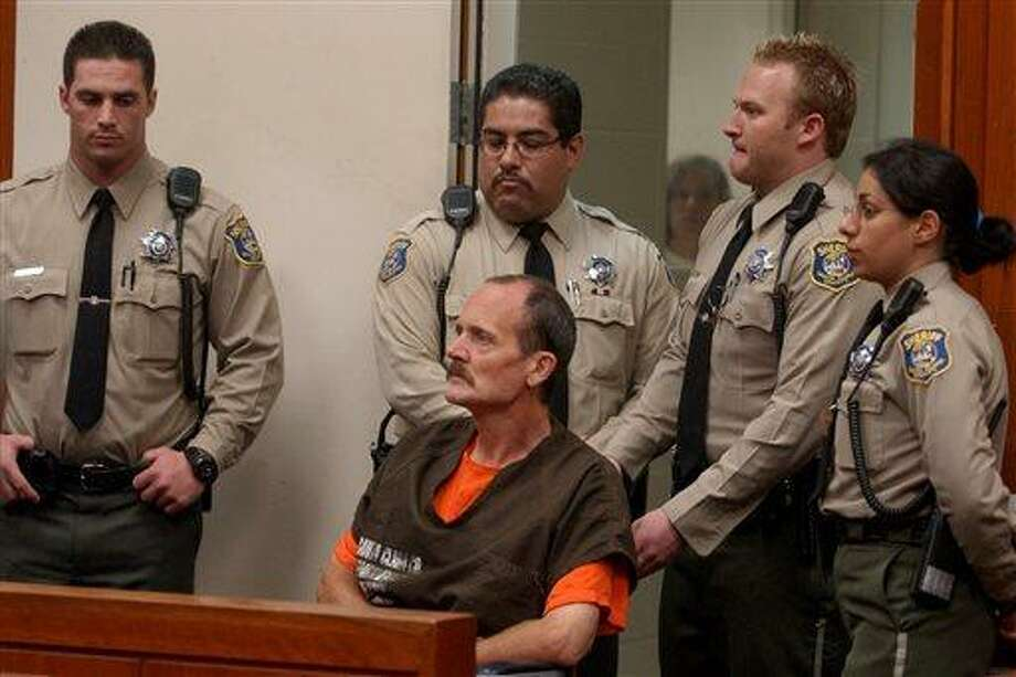 In this Thursday, May 13, 2004 file photo, Curtis Dean Anderson is surrounded by sheriff deputies as he listens to a judge during his arraignment in a San Jose, Calif., courtroom. Anderson, convicted of kidnapping and murdering the 7-year-old girl, also claimed to have killed several young women in California, so the FBI is now asking for help in identifying those alleged victims. (AP Photo/Paul Sakuma, file) Photo: AP / AP