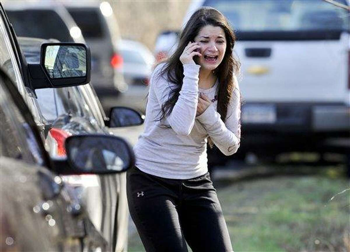 FILE - In this Dec. 14, 2012, file photo, Carlee Soto reacts as she learns her sister, Victoria Soto, a teacher at the Sandy Hook Elementary School, was one of 26 people killed in a shooting at the school in Newtown, Conn. Absent a magic potion or explosive economic growth, it was all but inevitable President Barack Obama would have to break some of his campaign promises to keep others, because of their incompatibility. In recent years, America has had many scenes of mass shootings. The campus of Virginia Tech University. A shopping center in Tucson, Ariz. A movie theater in Aurora, Colo. A temple in Oak Creek, Wisc. None put gun control back on the national agenda in a serious way. Then came the elementary school massacre in Newtown, Conn., after the election, and that all changed. Or so it seemed. (AP Photo/Jessica Hill, File)