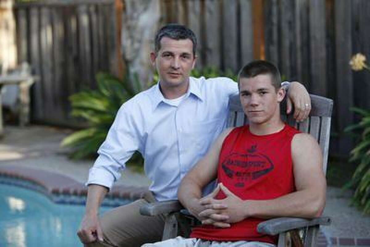 Alec Smith, 16, and his father, Justin Smith, at home in San Jose, Calif., on April 11.