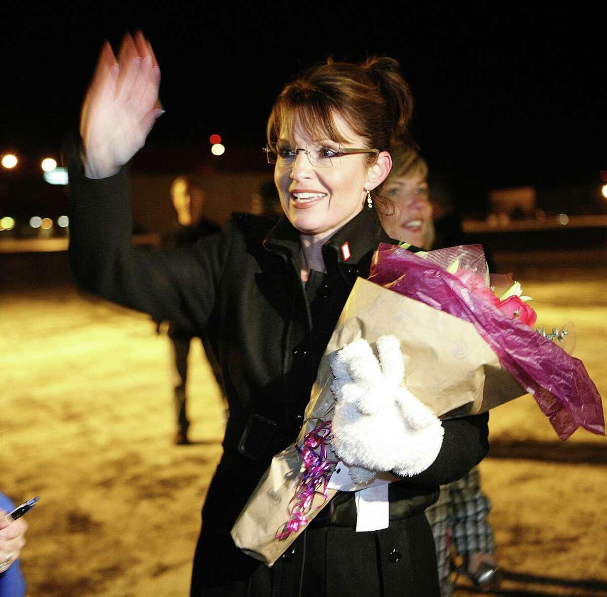 AP Photo/Al Grillo Former Alaska Gov. Sarah Palin greets supporters after returning to Anchorage, Alaska in 2008.