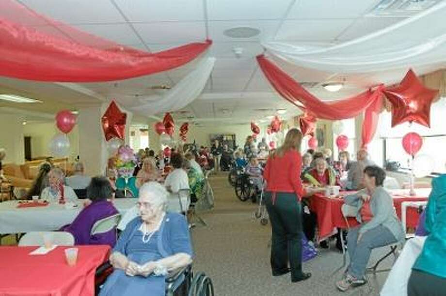 Sandy Aldieri/Special to the Press Family and friends gathered to celebrate National Nursing Home Week at the Water's Edge Senior Ball in Middletown Wednesday.