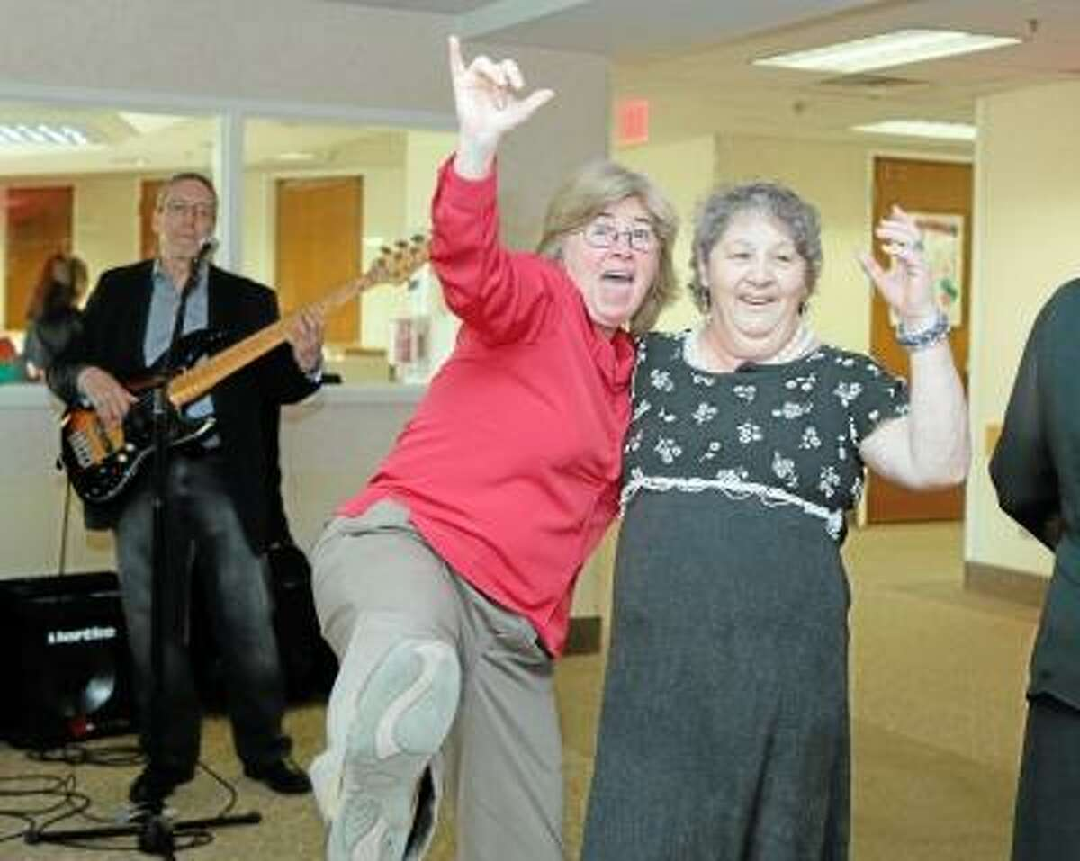 SAndy Aldieri/Special to the Press Darlene Behr, a member of the Water's Edge staff, and resident Yvette Courtis dance at the facility's Senior Ball, one of the many events the center is hosting to celebrate National Nursing Home Week in Middletown.