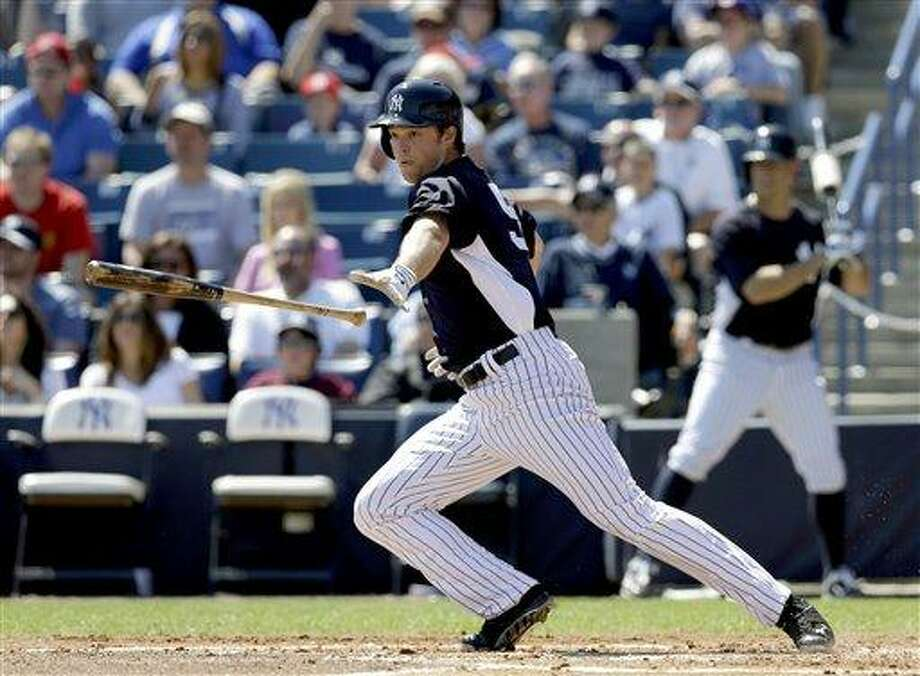 New York Yankees' Brennan Boesch bats against the Philadelphia Phillies in the first inning of a spring training exhibition baseball game in Tampa, Fla., Saturday, March 16, 2013. Boesch made his Yankees' debut, starting in right field and going 0 for 3 as a New York split squad lost 7-0 to the Phillies. (AP Photo/Kathy Willens) Photo: AP / AP
