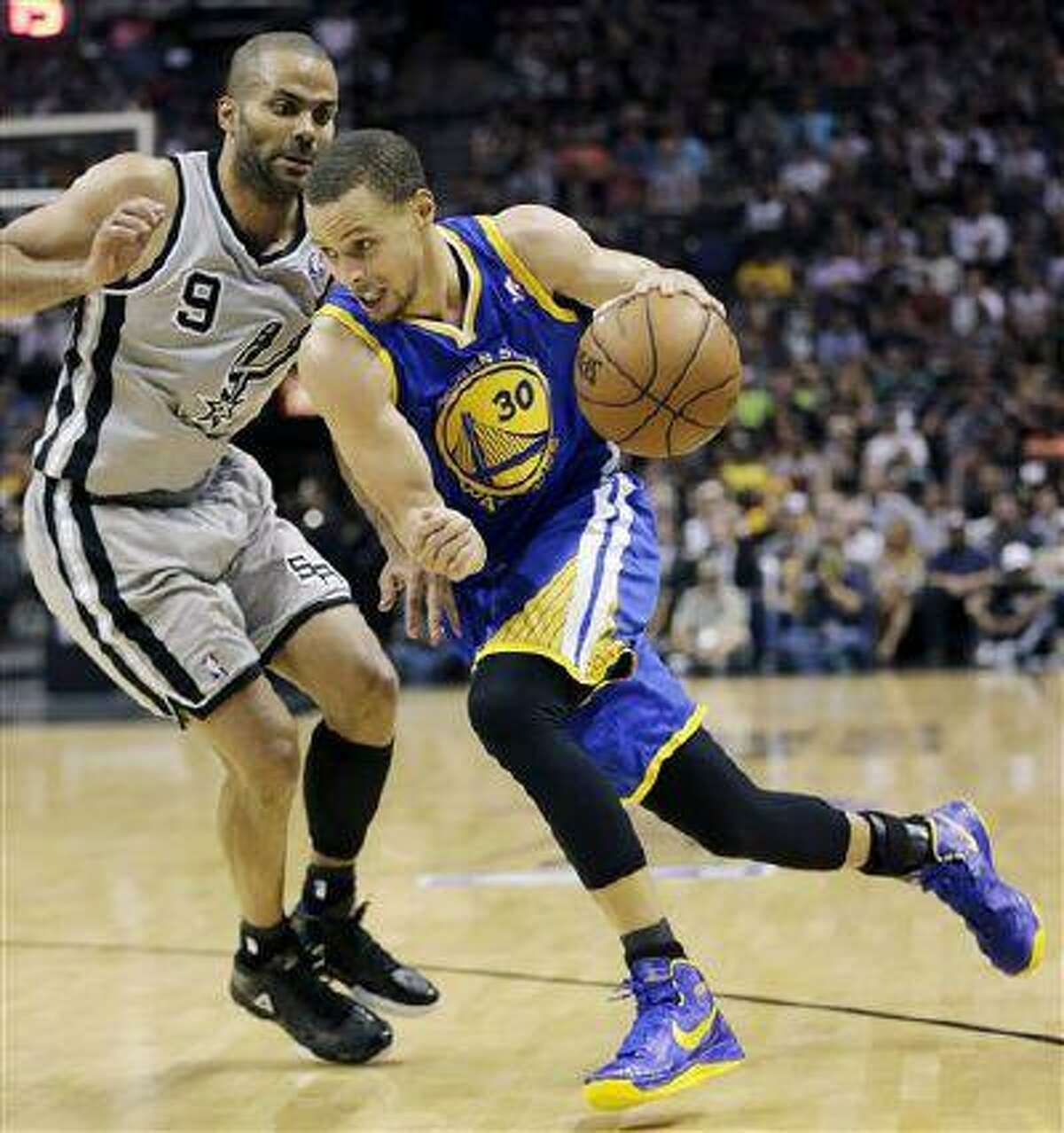 Golden State Warriors' Stephen Curry (30) drives on San Antonio Spurs' Tony Parker (9) during the second half in Game 5, May 14, 2013, in San Antonio.