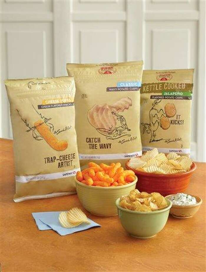 """This product image provided by Safeway shows its """"Snack Artist"""" brand of snacks. Supermarkets including Kroger, Safeway and Whole Foods are improving the image of their store brands with better packaging and more distinctive offerings. (AP Photo/Safeway) Photo: AP / Safeway"""