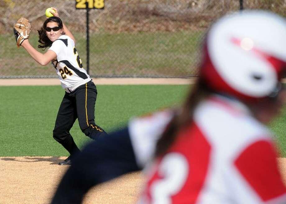 "Foran at Hand High School (Madison) softball. Hand's Allie Buller about to make the out at first as Foran's Rebekah DeRosa runs. Mara Lavitt/New Haven Register <a href=""mailto:mlavitt@newhavenregister.com"">mlavitt@newhavenregister.com</a>  4/15/13"