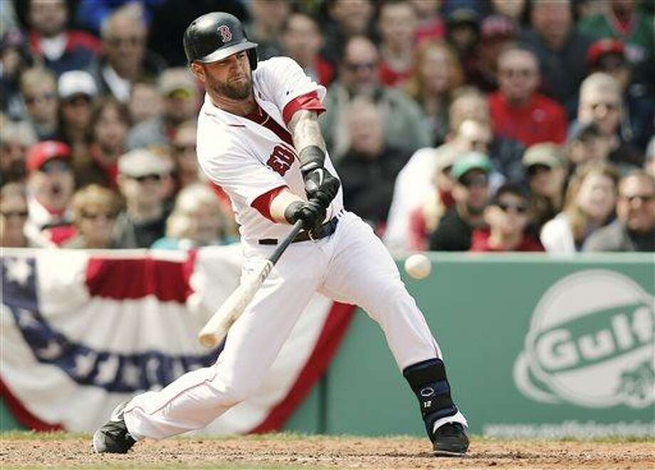 Boston Red Sox's Mike Napoli hits a game-winning RBI double against the Tampa Bay Rays during the ninth inning of a baseball game at Fenway Park in Boston on Monday, April 15, 2013. Boston won 3-2. (AP Photo/Winslow Townson) Photo: AP / FR170221 AP