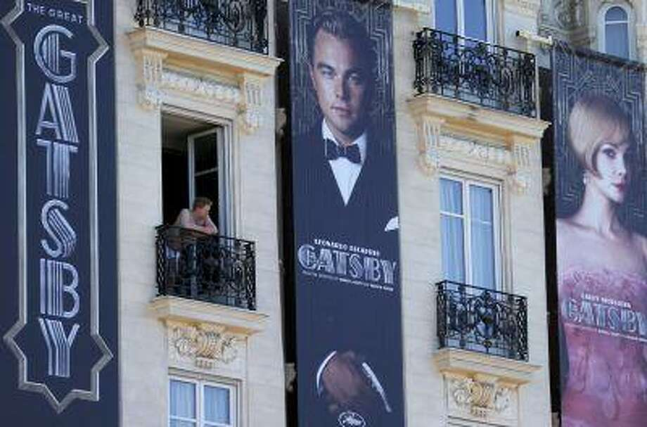 Posters for the film 'The Great Gatsby' showing actor Leonardo DiCaprio (C) and actress Carey Mulligan (R) are displayed outside the Carlton Hotel before the start of the 66th Cannes Film Festival in Cannes May 13, 2013. Photo: REUTERS / X00095